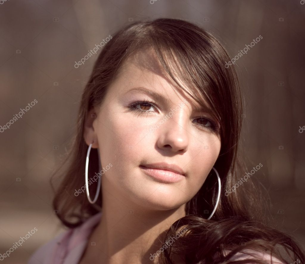 Portrait of young woman in reddish tones. — Stock Photo #1634958