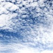High contast fleecy clouds — Stock Photo