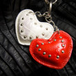 White and red heart on a chain — ストック写真