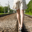 Girl walking on a railway — 图库照片