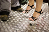 Woman foots on a high heel — Stock Photo