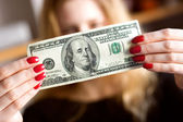 Dollar in front of face — Stock Photo