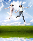 Happy jumping girls — Stok fotoğraf