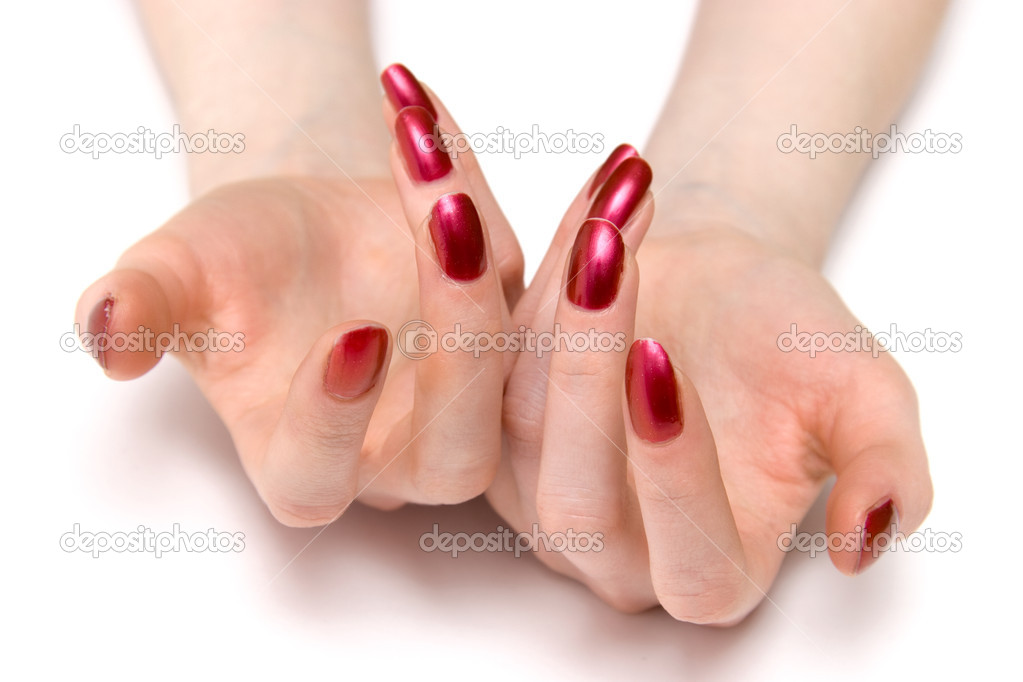 Woman showing her red nails. On white.  Stock Photo #1651864