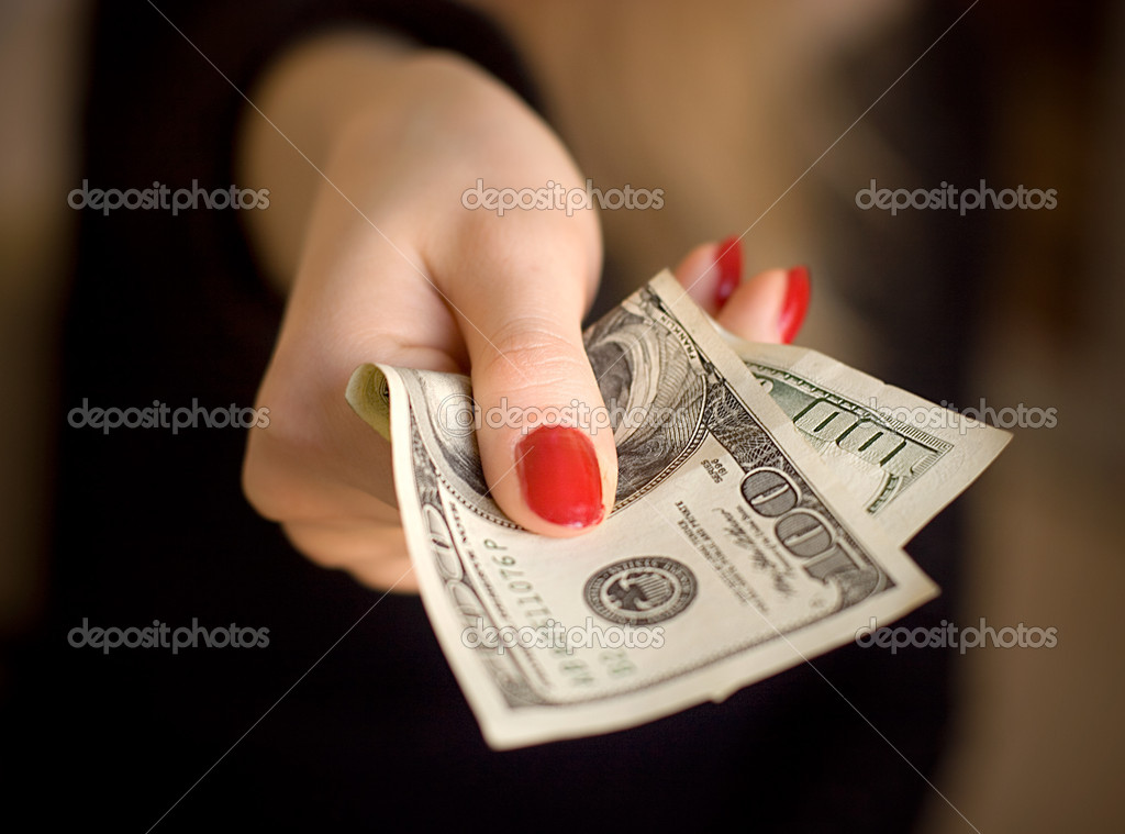 Woman hand giving money. Specially very small DOF.  Stock Photo #1651906