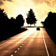 Road with lonely car — Stockfoto