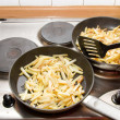 Stock Photo: Frying potatoes on two pans