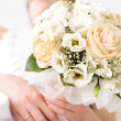 Bride with bunch of flowers — Stock Photo