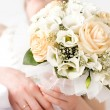 Bride with bunch of flowers — Stock Photo #1676321