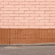 Brick wall and ground closeup - Stock Photo
