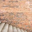 Old brick wall with stairs - Stock Photo