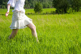 Girl walking on a field — Stock Photo