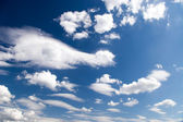 High contrast blue sky with clouds — Stock Photo