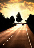 Road with lonely car — Stock fotografie