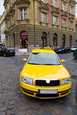 Yellow taxi wide angle view — Stock Photo