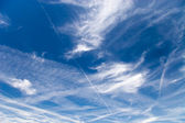 Blue sky with fleecy clouds — Stock Photo