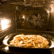 Cooking a pie in modern oven — Stock Photo