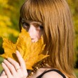 Girl with maple leaf - Stock Photo