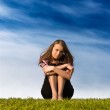 Young woman sitting on a grass — Stock Photo #1695807