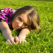 Joyful girl on a green grass — Stock Photo #1695842