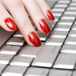 Woman fingers on computer keyboard — Stock Photo