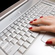 Woman fingers on laptop keyboard — Stock Photo