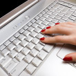 Stock Photo: Woman fingers on laptop keyboard