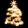 New year tree created from sparks — Stock Photo