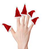 Woman hand with santa hats — Stock Photo