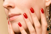 Elegant fingers on woman face — Stock Photo
