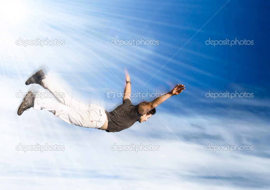 Flying man. Young man falling down on sky background. — Stock Photo #1696028