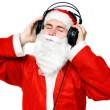 Santa Claus listening music - Stock Photo