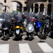 Lots of motorcycles in a city - Stock Photo