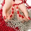 Two woman hands with glassbeads - Stock Photo