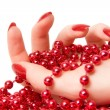 Woman hand with red glassbeads closeup — Stock Photo