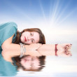 Young woman resting on a water surface — Stock Photo