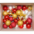 Box with new year tree decorations — Stock Photo