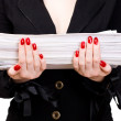 Businesswoman with heap of papers — Stock Photo