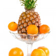 Oranges, mandarin and pineapple - Stock Photo