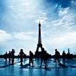 Walking silhouettes in Paris - Stock Photo