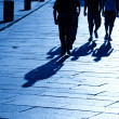 Foto Stock: Four walking shadows