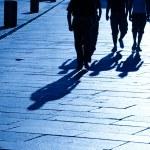 Four walking shadows — Stock Photo