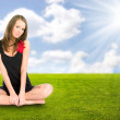 Young woman resting on a grass — Stock Photo #1715062