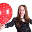 Young happy woman holding balloon — Stok fotoğraf