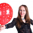 Young happy woman holding balloon — Stock Photo