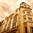 Old building in red dramatic colors - Stock Photo