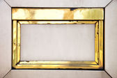 Old golden frame on a wall — Stock Photo