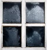Window frame with frozen glass — Stock Photo