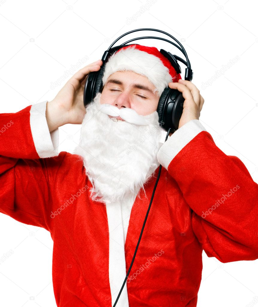 Santa Claus listening music. Isolated on white.  Stock Photo #1714778