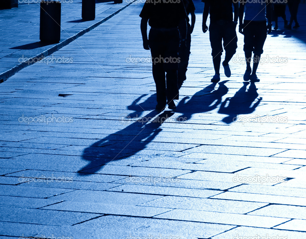 Four walking shadows. Blue tint. — Stock Photo #1715060